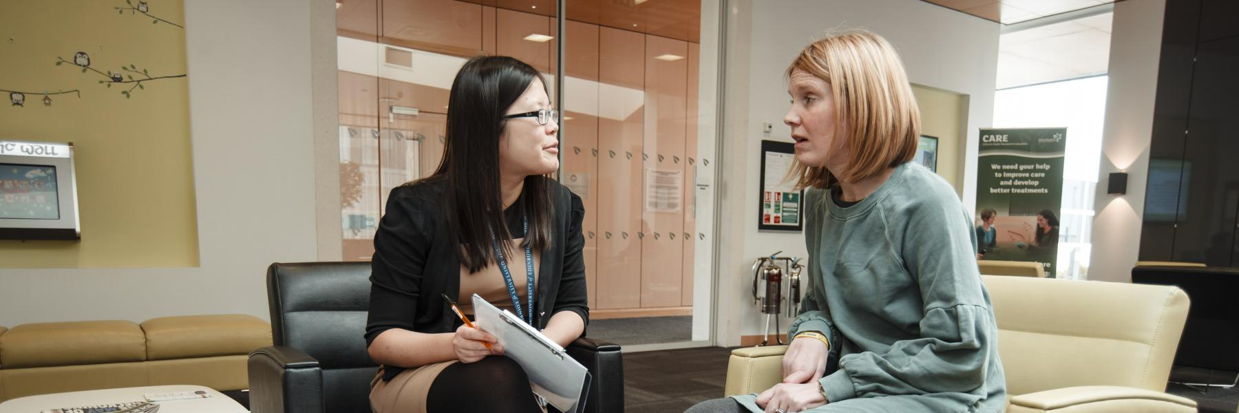 researcher discussing paperwork with a patient